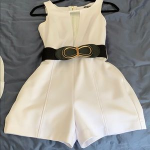 White romper with black and gold belt